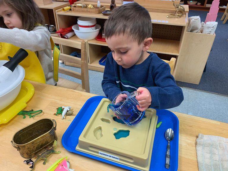 Preschooler working on science project
